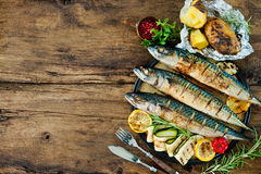 Grilled mackerel fish with baked potatoes Stock Photos