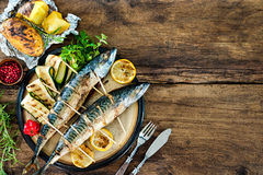 Grilled mackerel fish with baked potatoes Royalty Free Stock Images