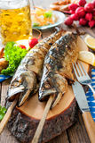 Grilled mackerel fish with beer and pretzel Stock Image