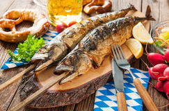 Grilled mackerel fish with beer and pretzel Stock Photos