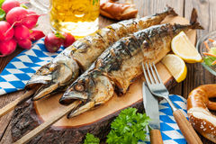 Grilled mackerel fish with beer and pretzel Stock Photo