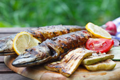 Grilled mackerel fish with lemon and vegetables Royalty Free Stock Photos