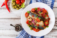 Grilled mackerel with vegetables in Mediterranean style. Royalty Free Stock Photo