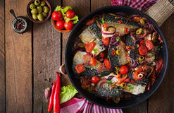 Grilled mackerel with vegetables in Mediterranean style. Stock Photo