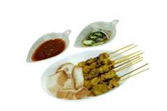 Grilled marinated pork satay with sweet and sour sauce and peanut sauce, isolated on white background Stock Image
