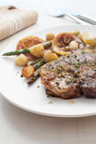 Grilled meat with asparagus and young potatoes Stock Photos