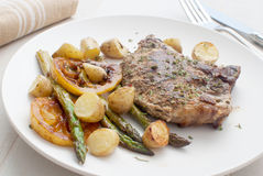 Grilled meat with asparagus and young potatoes Stock Image