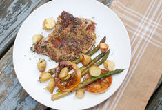 Grilled meat with asparagus and young potatoes Royalty Free Stock Photography