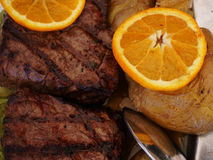 Grilled meat with baked potato Stock Photos