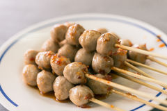 Grilled meat ball with sweet spicy sauce Royalty Free Stock Images