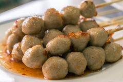 Grilled meat ball with sweet spicy sauce Stock Images