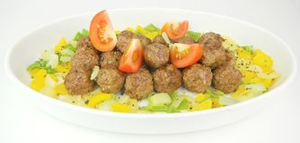 Grilled Meat Balls. Accompanied with Capsicums and Tomatoes on White Plate Stock Photography