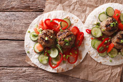 Grilled meat balls with fresh vegetables on a flat bread. Horizo Royalty Free Stock Photo