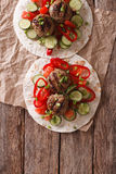 Grilled meat balls with fresh vegetables on a flat bread. Vertic Royalty Free Stock Image