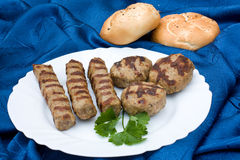 Grilled meat balls and rissole Stock Photos