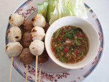 Grilled meat balls with spicy dipping sauce and vegetables. Royalty Free Stock Images