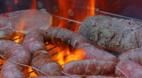 Grilled meat barbecue with pork and sausages 16 Stock Photos