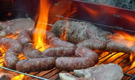 Grilled meat barbecue with pork and sausages 17 Royalty Free Stock Photography