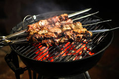 Grilled meat on barbeque. Grilled meat on barbecue ready to eat Royalty Free Stock Photo