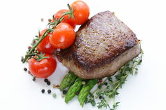 Grilled meat beef steak with vegetable garnish Stock Photography