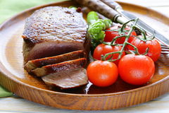 Grilled meat beef steak with vegetable garnish Stock Images