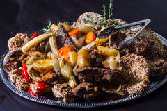 Grilled meat with boiled potatoes and vegetables Stock Photography
