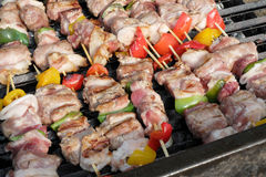 Grilled meat and brad. Grilled meat sausage skewers pork steaks and cow Stock Image