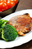 Grilled meat with broccoli Stock Images
