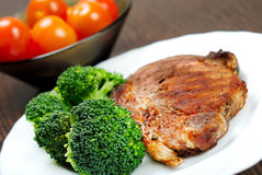 Grilled meat with broccoli. Plate with grilled meat and broccoli Stock Photography