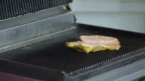 Grilled meat for burger on electric grill stock video footage