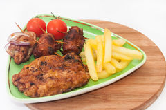 Grilled meat with cherry potato served on a plate Royalty Free Stock Images