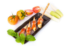 Grilled meat with corn on black plate Royalty Free Stock Photos