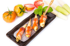 Grilled meat with corn on black plate Stock Photo