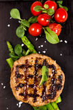 Grilled meat cutlet serving with asparagus and tomatoes Royalty Free Stock Image
