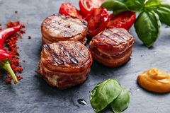 Grilled meat fillet steak wrapped in bacon Stock Photos
