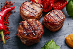 Grilled meat fillet steak wrapped in bacon Stock Photo