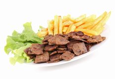 Grilled meat and french fries Stock Photos