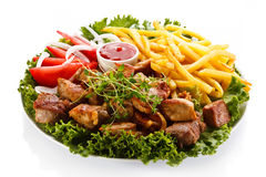 Grilled meat and French fries Stock Photo