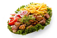 Grilled meat and French fries Stock Image