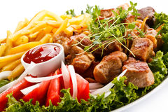 Grilled meat and French fries Royalty Free Stock Image