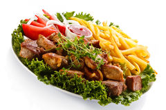Grilled meat and French fries Royalty Free Stock Photos