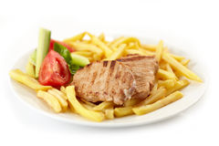 Grilled meat and french fries Royalty Free Stock Photo
