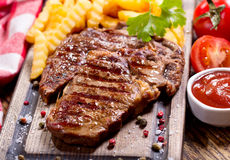 Grilled meat with french fries Royalty Free Stock Image