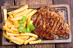 Grilled meat with french fries Stock Photo