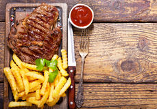 Grilled meat with french fries Royalty Free Stock Photo