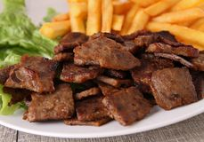 Grilled meat and fries Royalty Free Stock Images