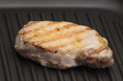 Grilled meat on the grill pan Royalty Free Stock Image