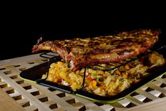Grilled meat. Grilled pork ribs with braised cabbage royalty free stock photography