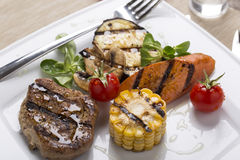 Grilled meat with grilled vegetables Royalty Free Stock Images