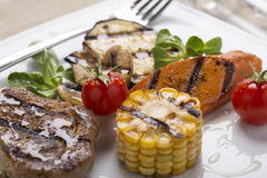 Grilled meat with grilled vegetables Stock Images
